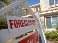Mortgage loan modification programs aim to make these signs less popular. Image from Flikr.