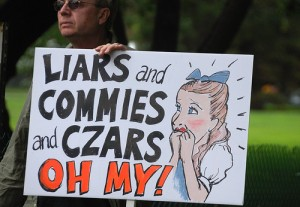 """Liars and commies and czars, oh my!"" reads one Tea Party Patriot's sign. What will the passage of the health care bill portend for America? Should we be signaling a Code Red?"